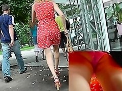Young babe in cute red dress in the upskirt video
